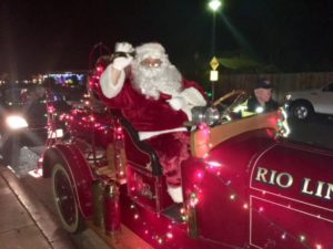 Santa Parade Draws Crowds and Presents
